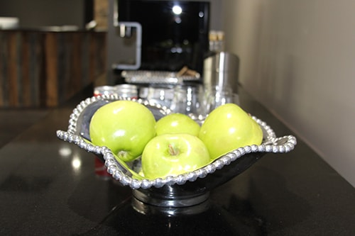 Apples in a bowl in the waiting room of this dentist in Raleigh, NC - The Dental Market