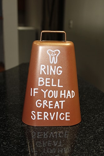 A bell that says %22Ring bell if you had great service%22 to show that this dentist in Raleigh, NC has an upbeat and casual atmosphere.