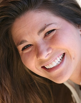 Portrait shot of an actual patient from The Dental Market. Smile makeover done by cosmetic dentist Raleigh, NC James Sarant DMD