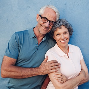 Older couple smiling after going through an oral cancer screening