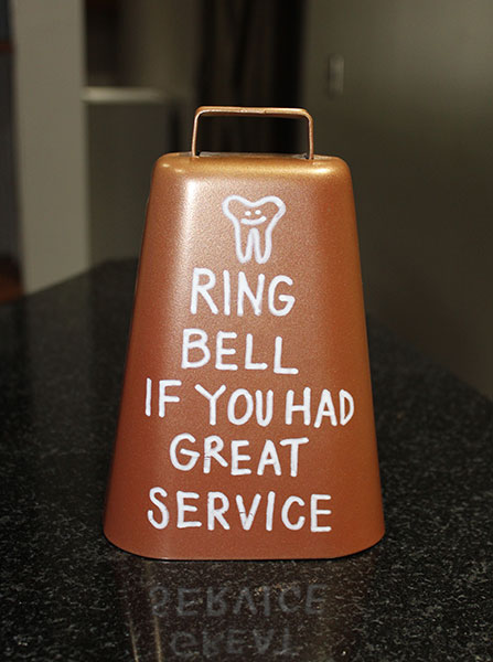 "Bell at The Dental Market, saying ""Ring bell if you had great service!"""
